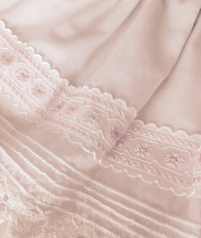 Pintucks and embroidered ribbon. I love heirloom details.