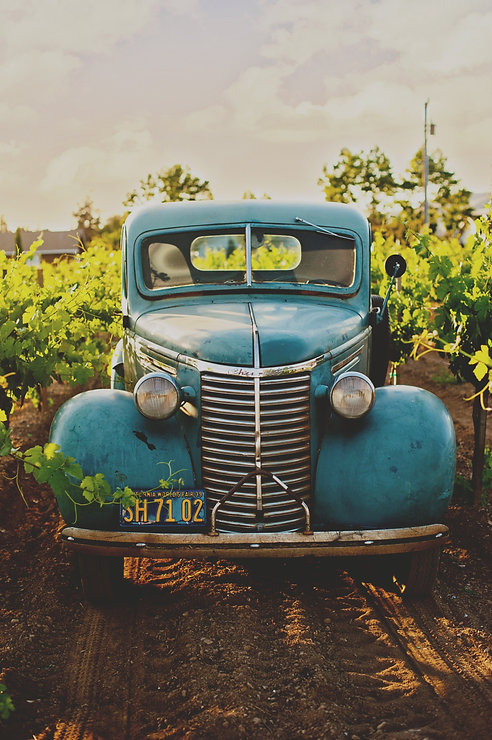 Blue vintage car on a dirt road_edited.jpg