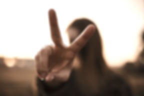 focus%20photography%20of%20woman%20hand%20with%20peace%20sign_edited.jpg