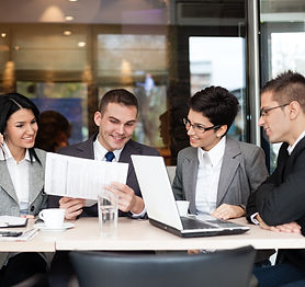Group of four young business people gath