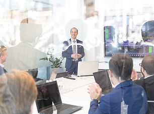 Business man making a presentation at of