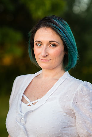 Portrait of Lizzie Stoxen, by Wildauer Photography, looking stoic with blue and green hair