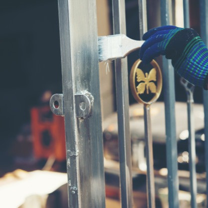 construction-worker-painting-fence-home_