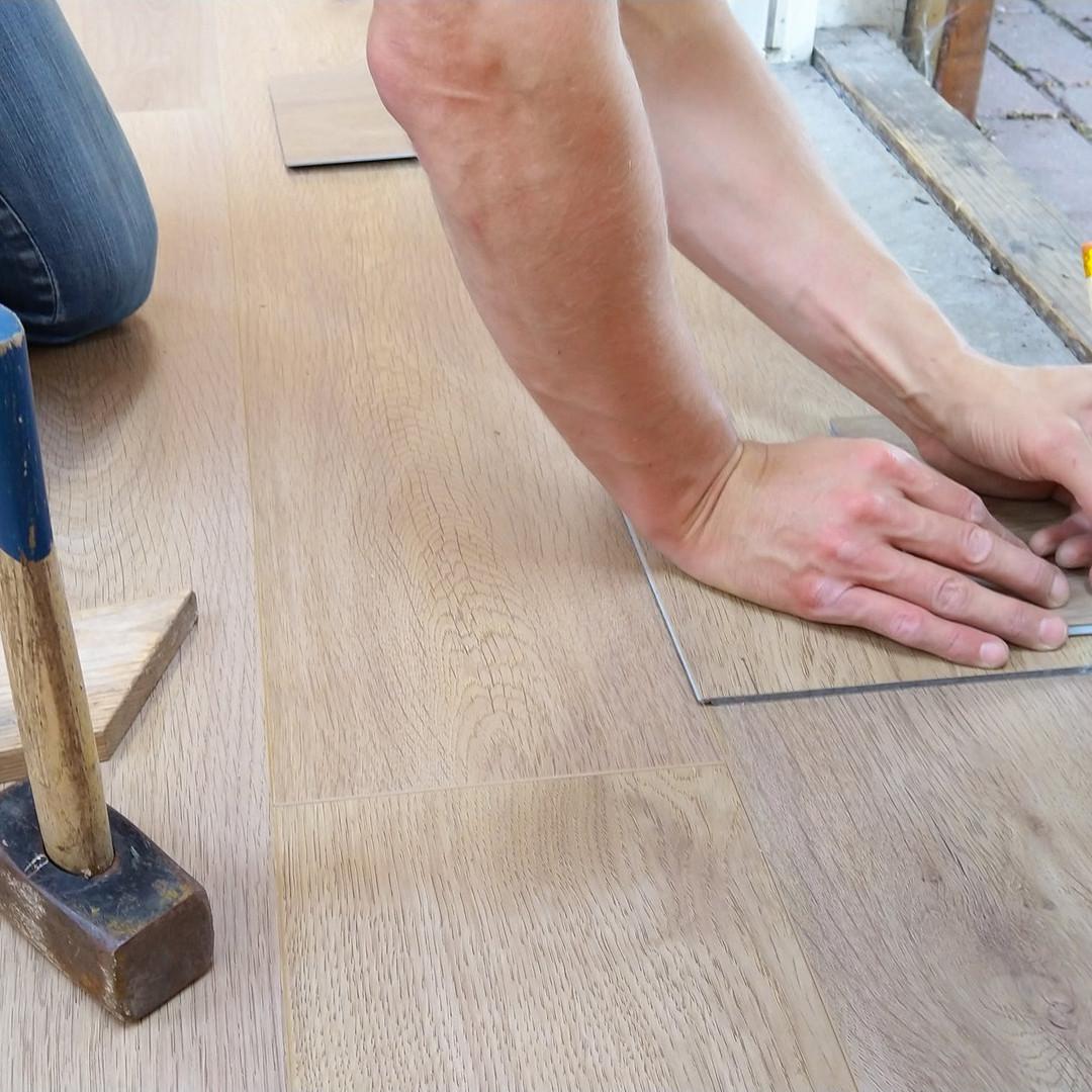 floor-flooring-hand-man-1388944_edited.j
