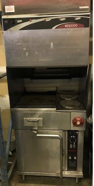 Wells ventless  hood with 2 burners with flat top griddle and oven below