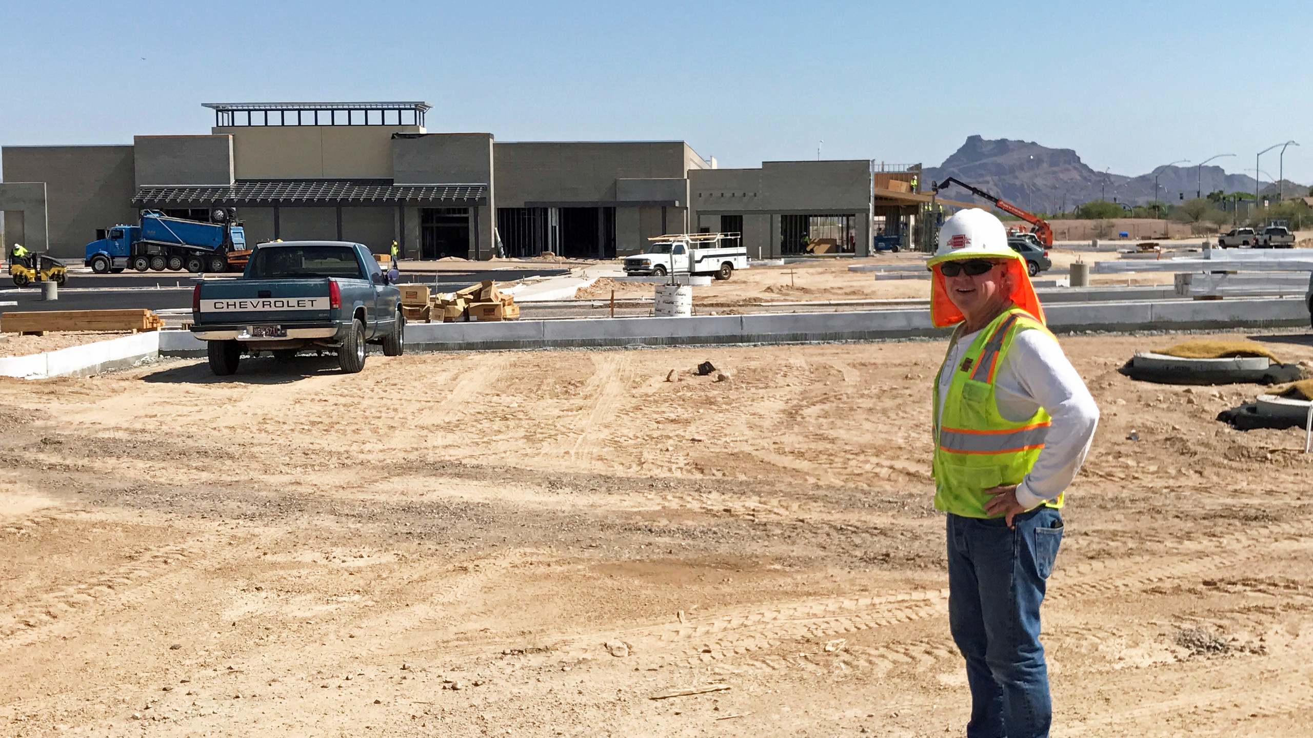 Superintendent, Jamie Lorimer for Alexander Building Co. with Sprouts in the background.  Asphalt provided by Alan Harris Trucking.