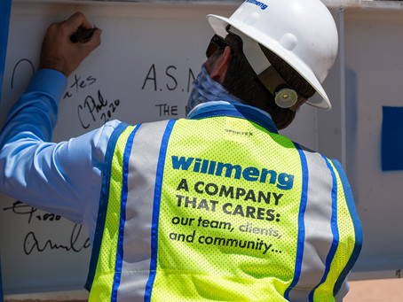 Willmeng Construction and Trammell Crow Company celebrate the topping out of Class A office developm
