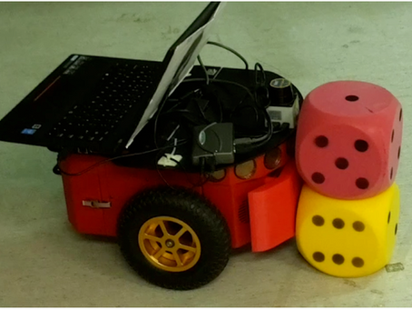 Feature-Based Transfer Learning for Robotic Push Manipulation