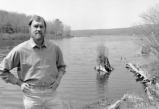 Photo of Joe Harcum in front of Duck Harbor Lake
