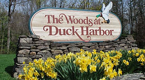 The Woods at Duck Harbor sign