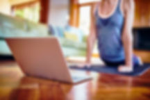 Woman-with-laptop-stretching-on-exercise