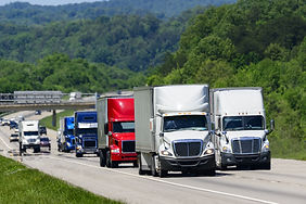 A squadron of eighteen-wheelers lead the