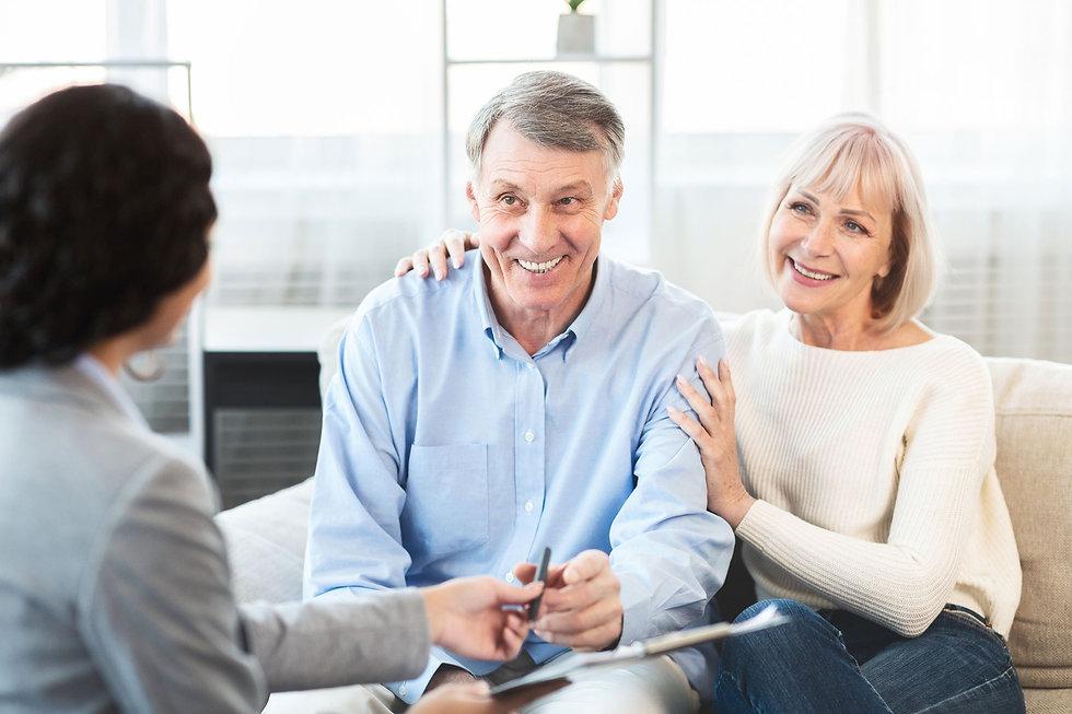 WEB-happy-mature-couple-talking-to-finan