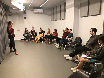 acting classroom with young acting students sitting in a semi circle