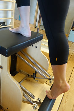 Step back on Pilates Chair