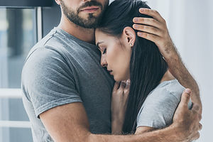 cropped shot of bearded man hugging and
