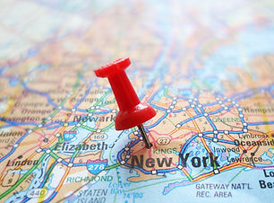 Closeup of a New York City map with red tack                               .jpg