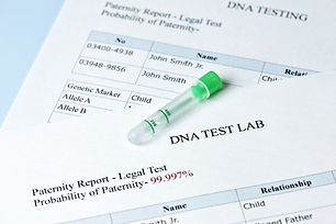 Paternity test results report with lab sample test tube..jpg