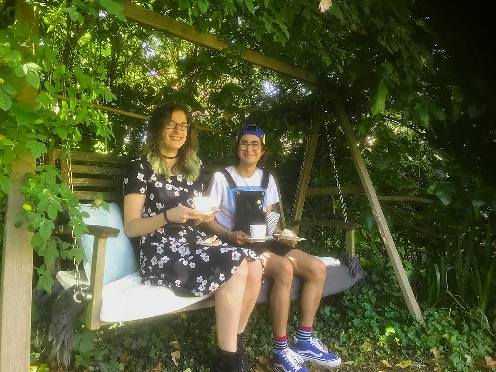 Charlie Hobbes and Carolina Brinkmann enjoying a cup of tea