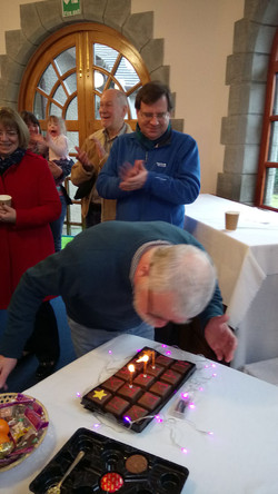Fr peter's 70th birthday, blowing out his candles.