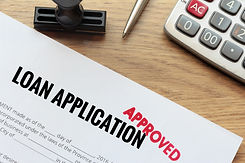 Approved loan application with rubber st