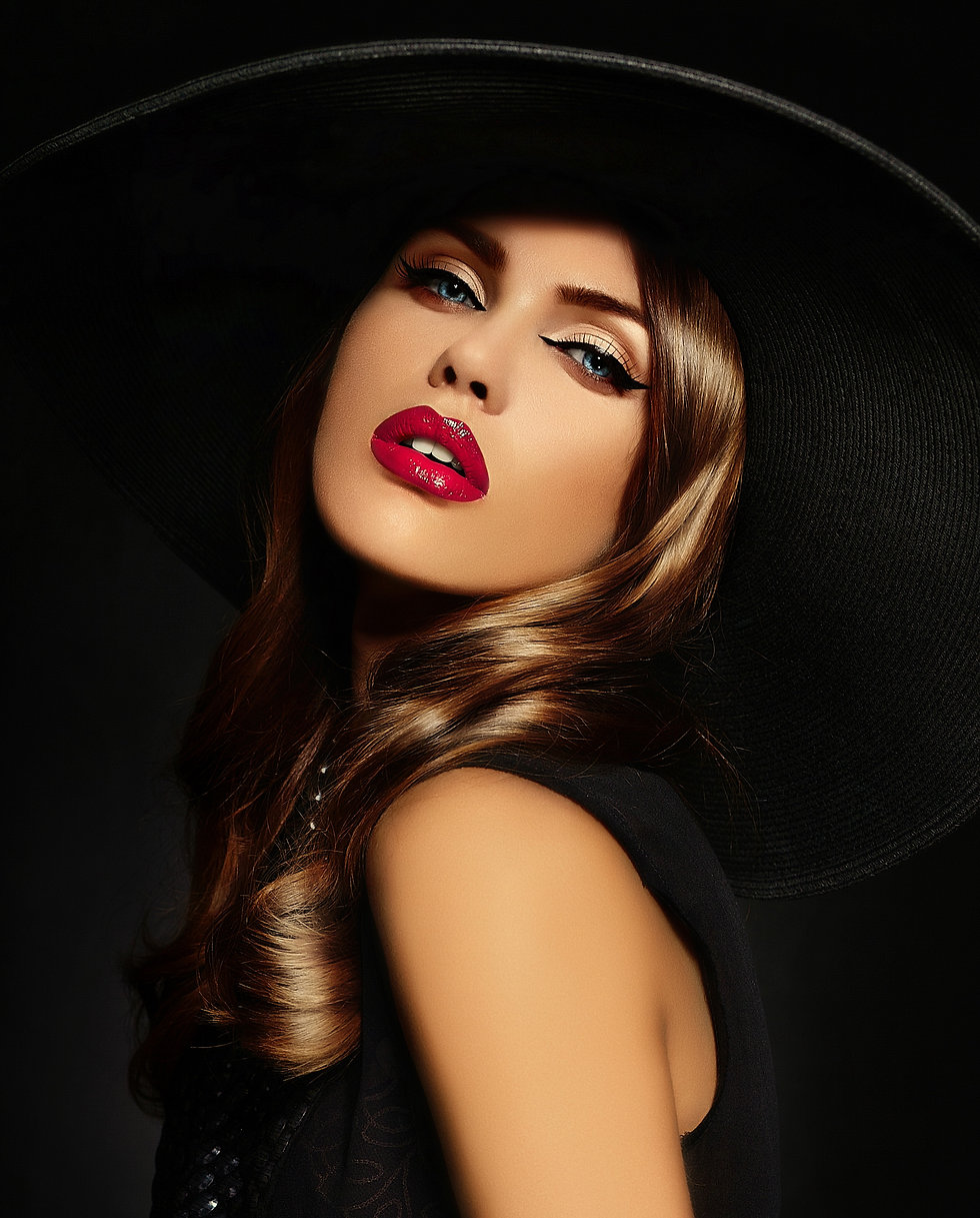 young-woman-with-bright-makeup-black-hat