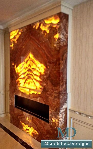 Каминный портал из оникса с подсветкой