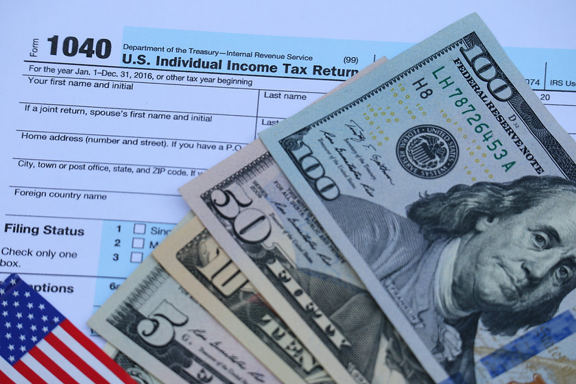 US tax form, dollar cash, US flag, pen,