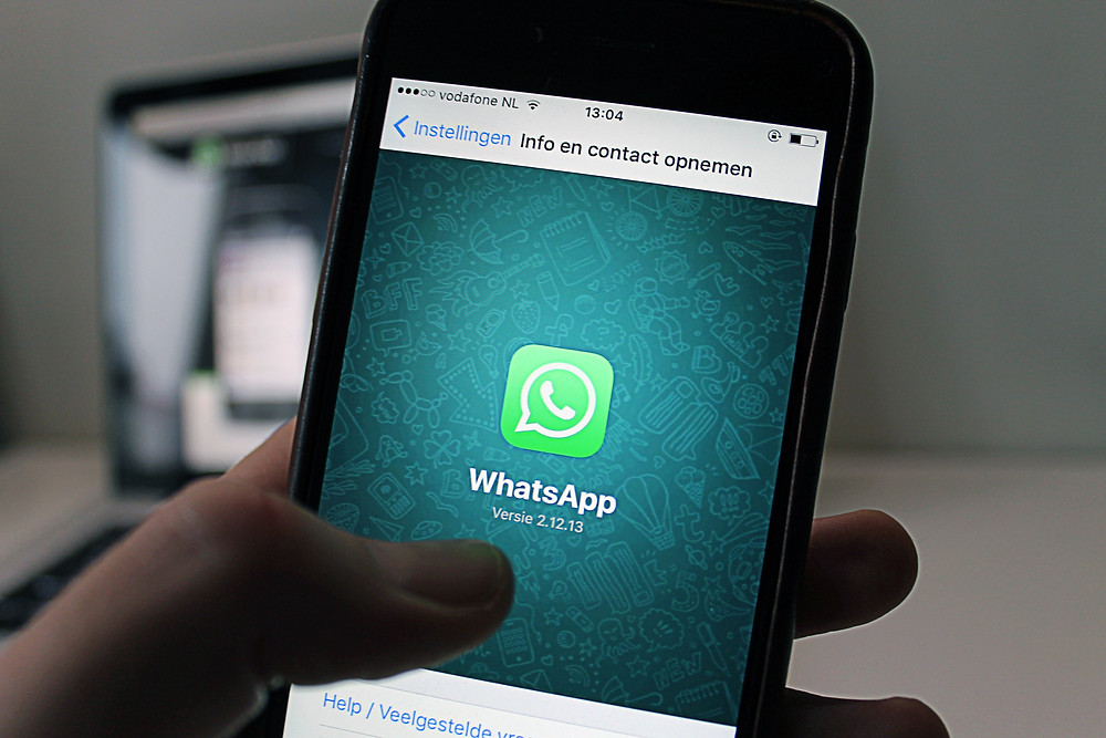 The screen of a mobile phone showing the icon of WhatsApp