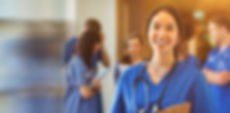 Medical student smiling at camera in uni