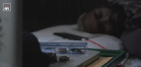 AXA - Ruben waking to pills.png