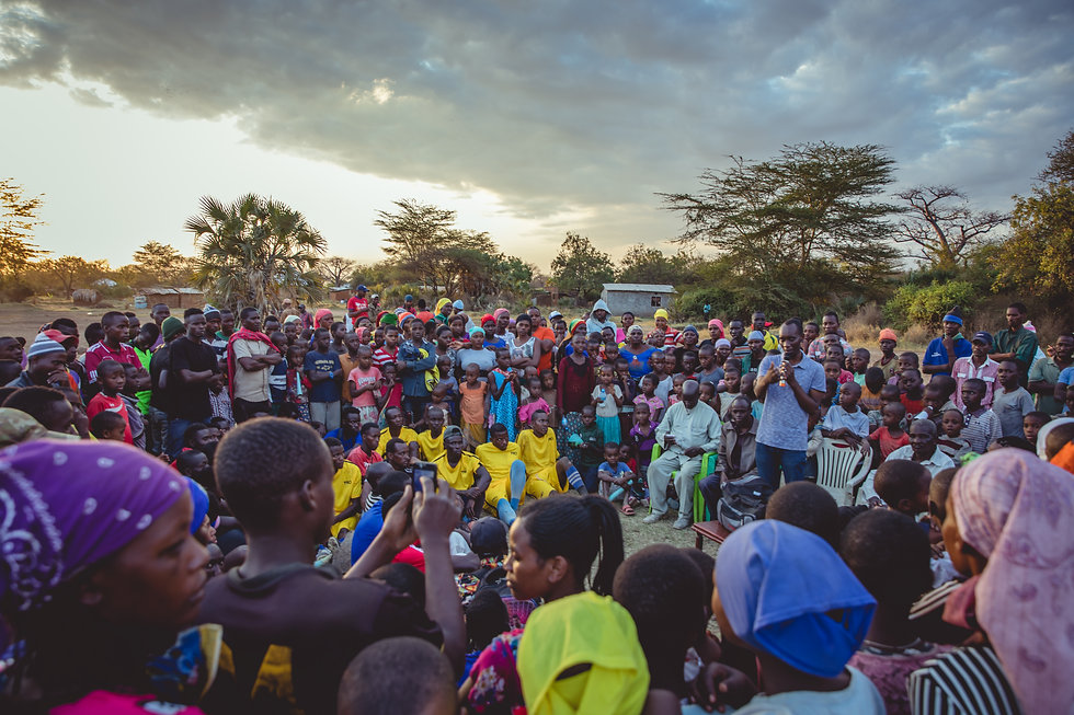 a crowd gathers in a circle in tanzania africa