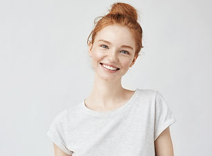 Headshot Portrait of happy ginger girl w
