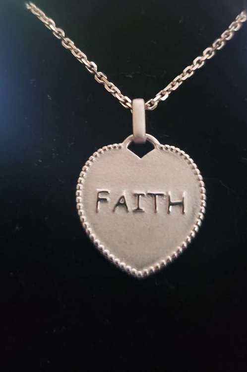 Faith silver pendantmeasures 20 mm in length by 19 mm in width