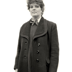 Woman In A Brown Coat