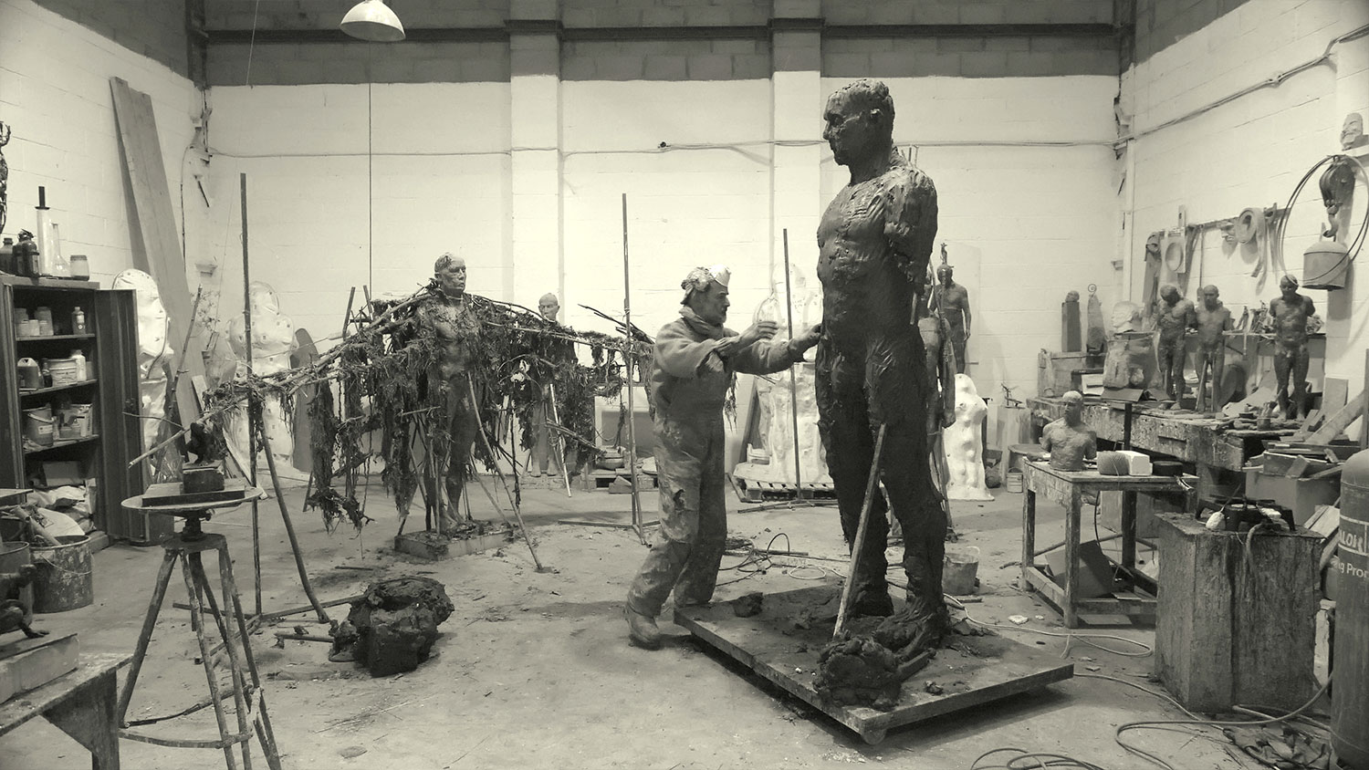 Laurence works on the clay sculpture