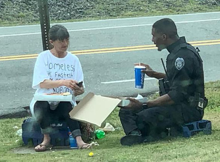 A police officer spent his lunch break sharing pizza with a homeless woman