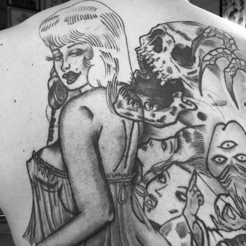 Large back piece tattoo