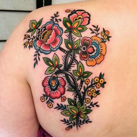 shoulder flower tattoo