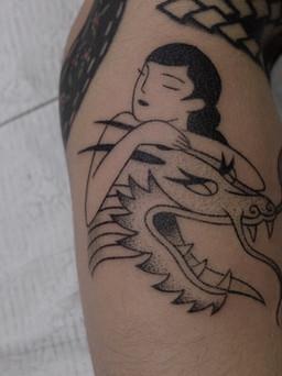 Female portrait and dragon head