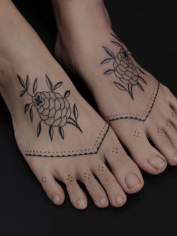 Delicate feet tattoos