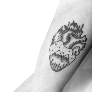 Heart and mountains arm tattoo