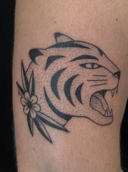 Feminine tiger tattoo