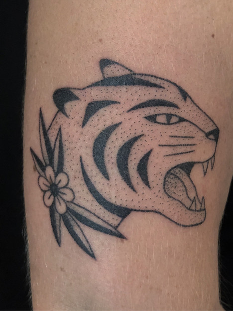 Feminine tiger tattoo