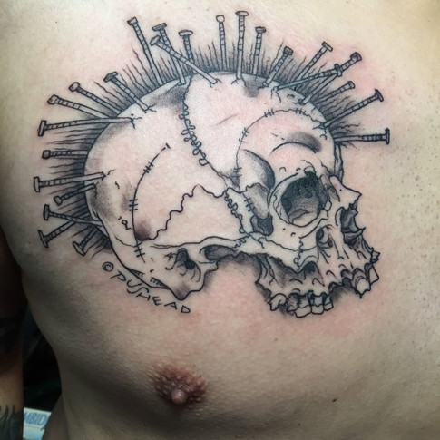 Black and grey pink skull tattoo by Sol