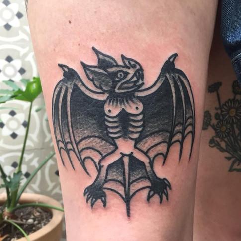 Blackwork bat tattoo
