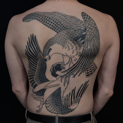 Eagle and duck fighting tattoo