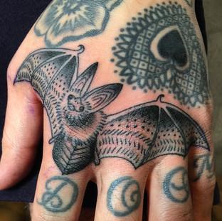 Bat finger tattoo