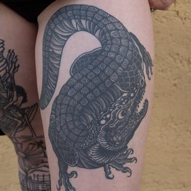 Black dragon tattoo