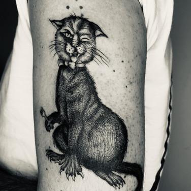 Black cat arm tattoo